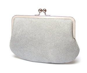 Image of White patterned leather clutch purse with chain handle
