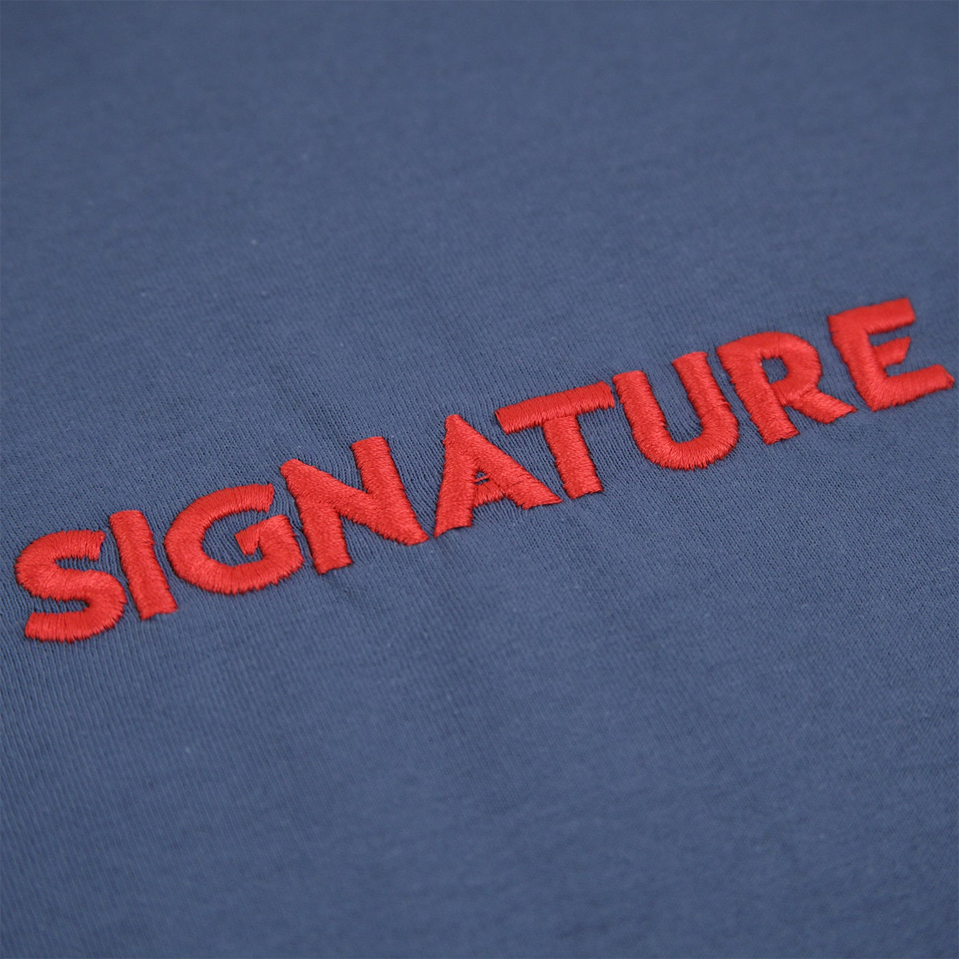 Image of Classic Logo Embroidered T Shirt - Indigo / Coral