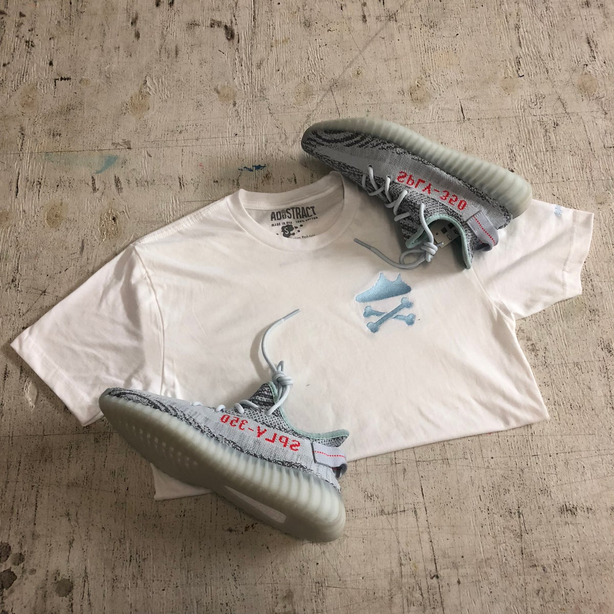 """Image of YEEZY CROSSBONES EMBROIDERY """"BLUE TINT"""" T-SHIRT"""