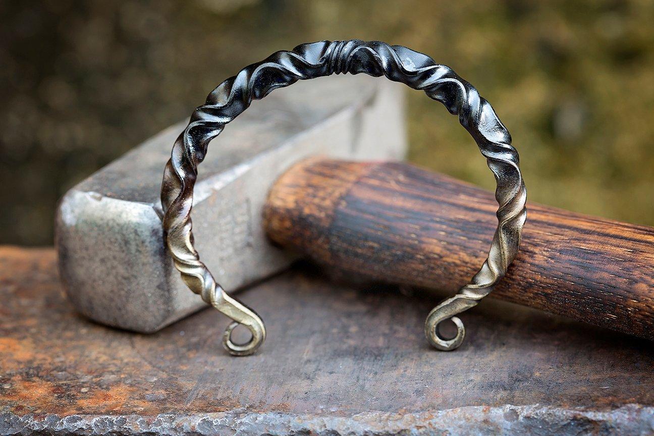 Image of bronzed Viking arm ring | reverse twist mild steel + bronze