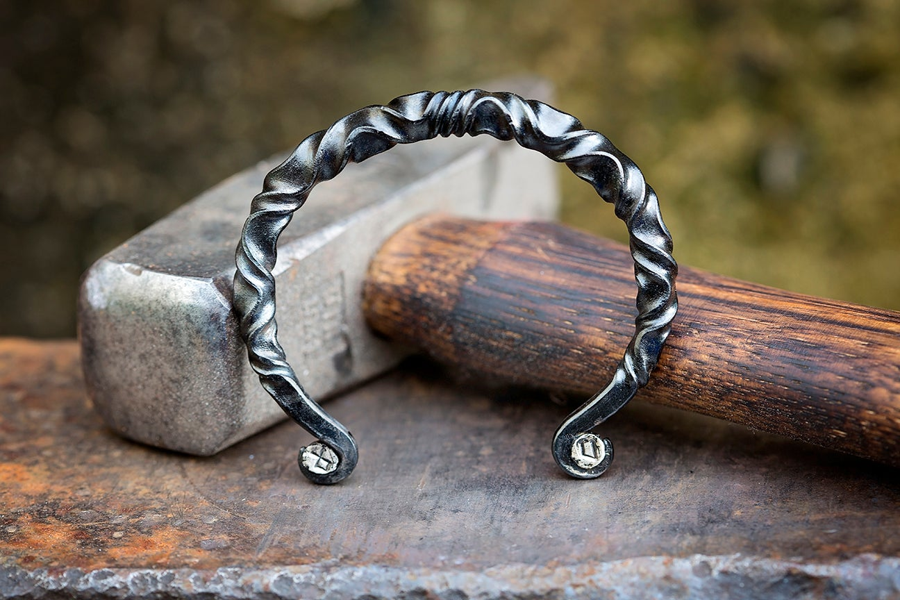 Image of Viking Steel Arm Ring with Silver Runes | reverse twist mild steel + sterling silver