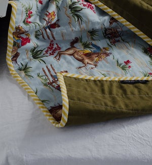 Image of Cowboys + Olive Linen Wholecloth Baby Quilt
