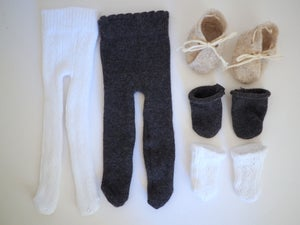 Image of 2 pairs of tights, 2 pairs of socks, and a pair of booties for my baby doll