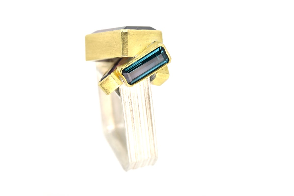 Tourmailne cluster monolith ring. Bi-colour and indicolite tourmaline set in 18ct and silver