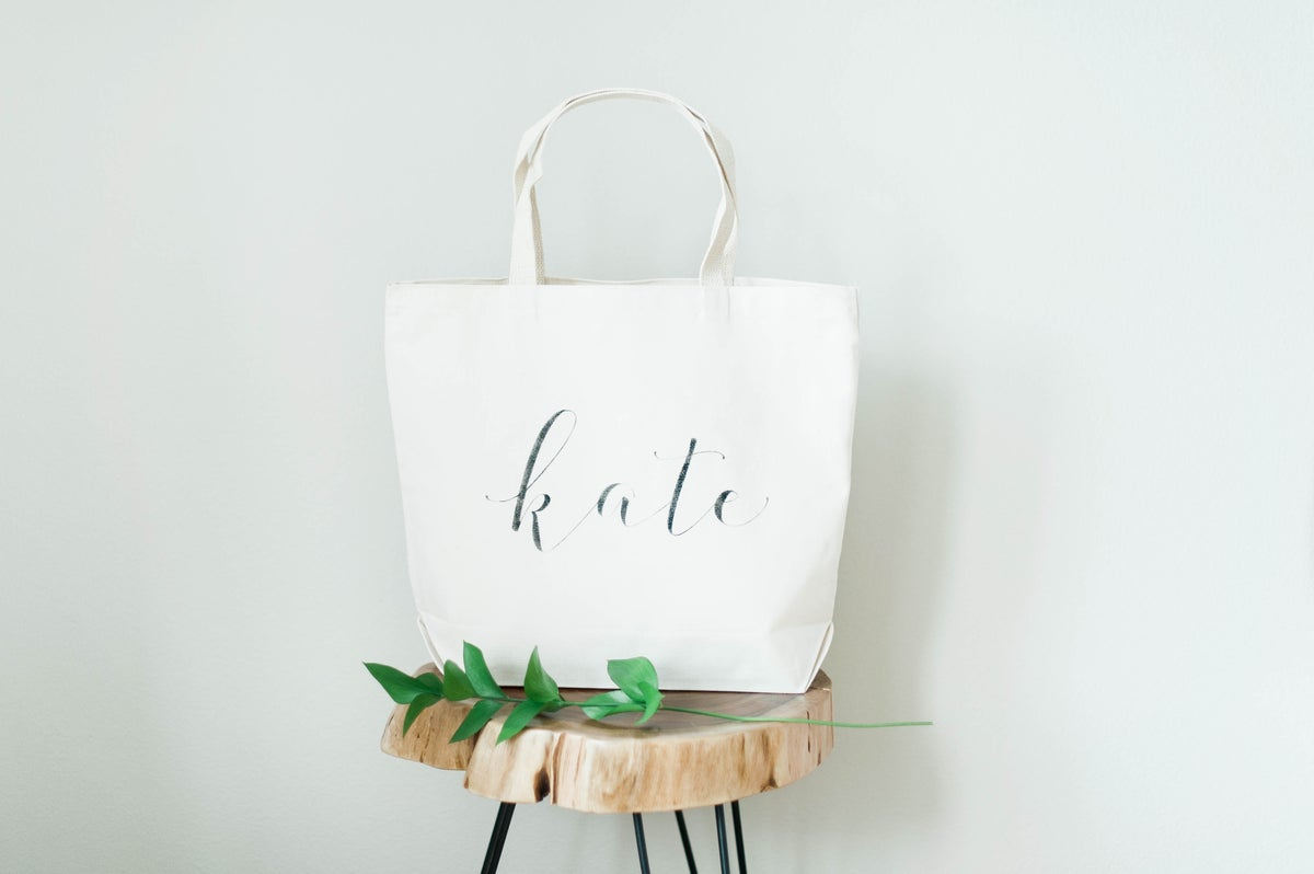 PERSONALIZED CANVAS TOTE WITH OUTER POCKETS