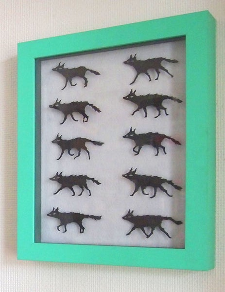 Image of paper silhouette wolves -- ONE OFF-- animation sequence