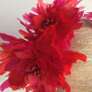Image of Red and pink feather headpiece