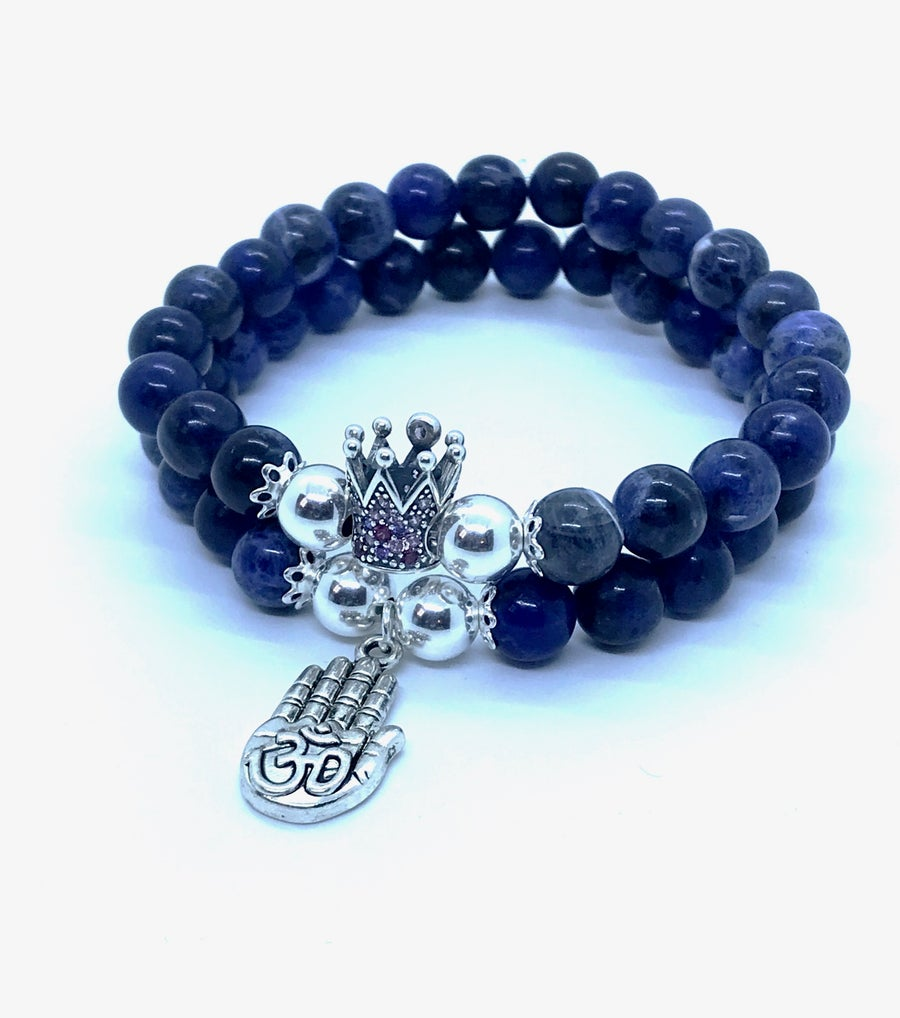 Image of 'Peaceful King' Sodalite double stacked stretch bracelet with silver beads,crown and Ohm charm.