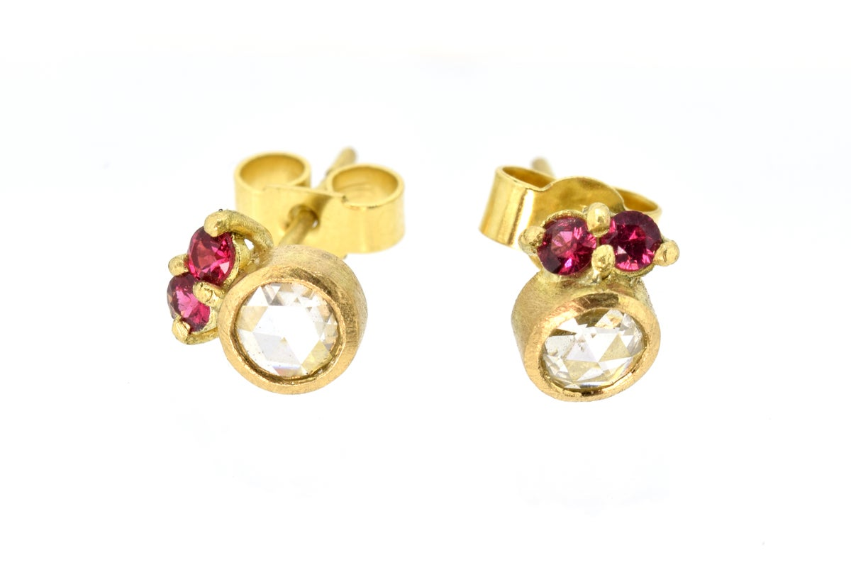 18ct gold studs set, each set with rose cut white diamond and two pink spinel.