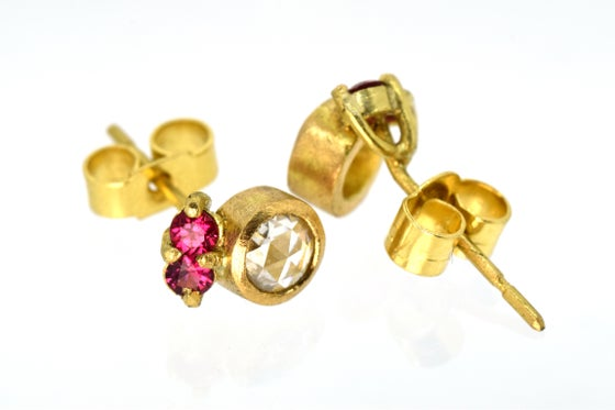 Image of 18ct gold studs set, each set with rose cut white diamond and two pink spinel.