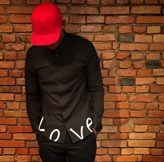 "Image of Long Sleeve ""Love."" Button Up"