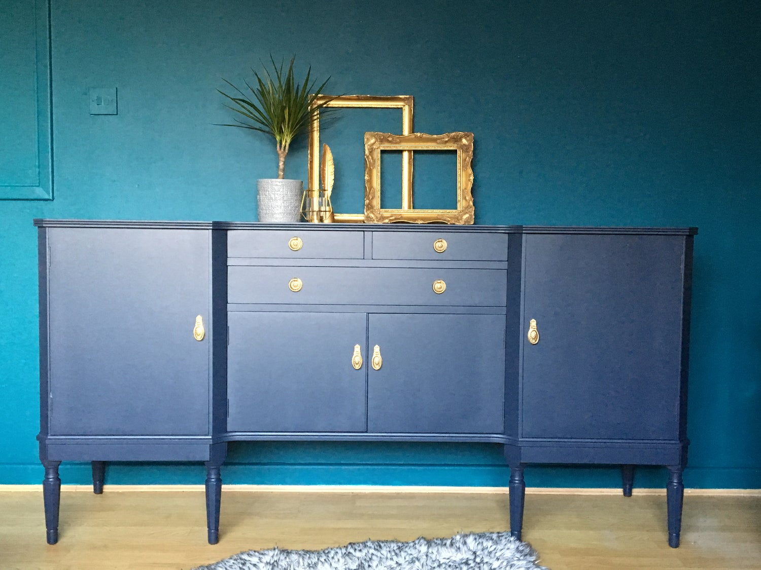 Image of Dark blue wooden sideboard