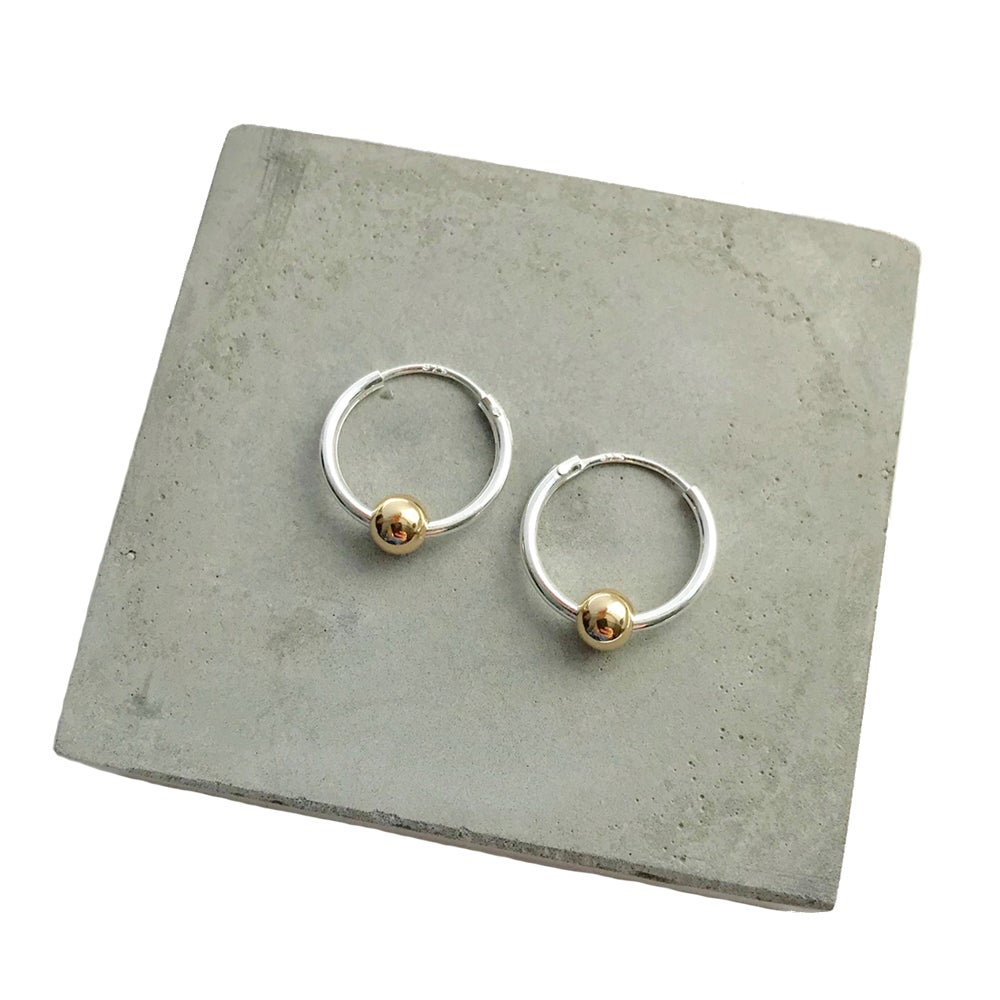 Image of Silver hoops with single gold bead