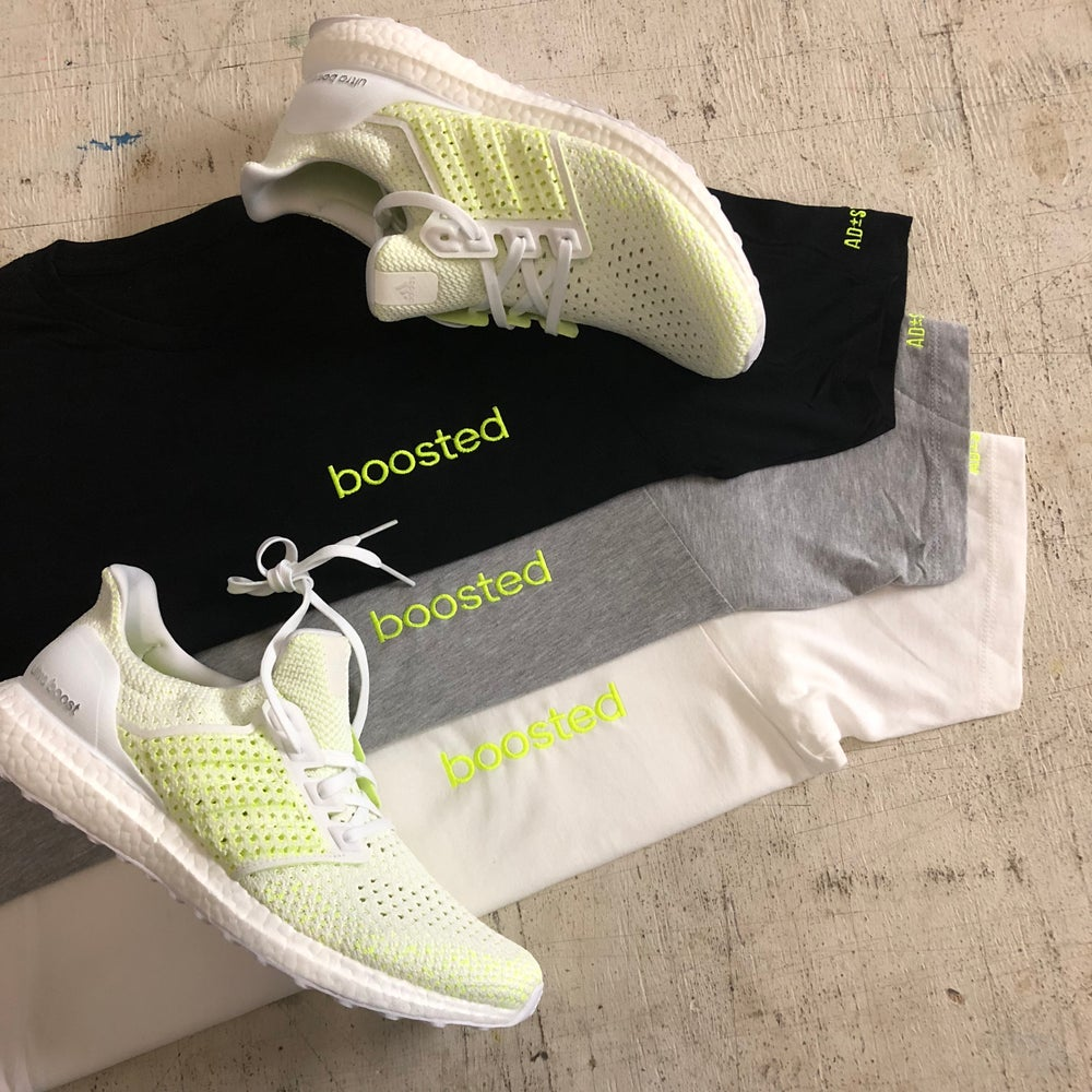 BOOSTED EMBROIDERY (NEON YELLOW LONG BODY T-SHIRT W/ SCALLOPED BOTTOM HEM