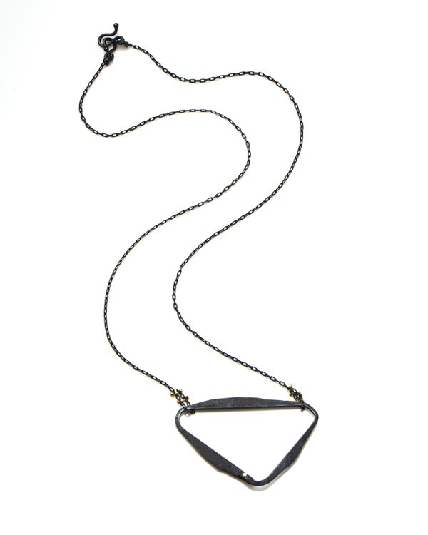 Image of Asymmetric loop blackened silver necklace with gold detail