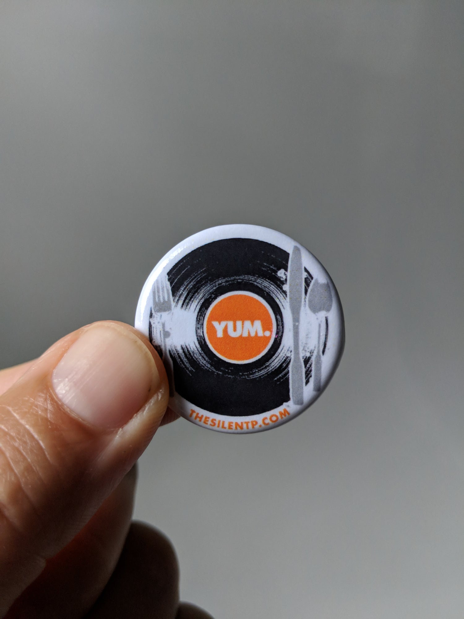 Image of YUM.  Round button