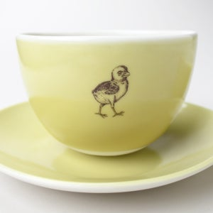 Image of good morning set: wee tea cup, bowl, plate, in mustard with baby chick