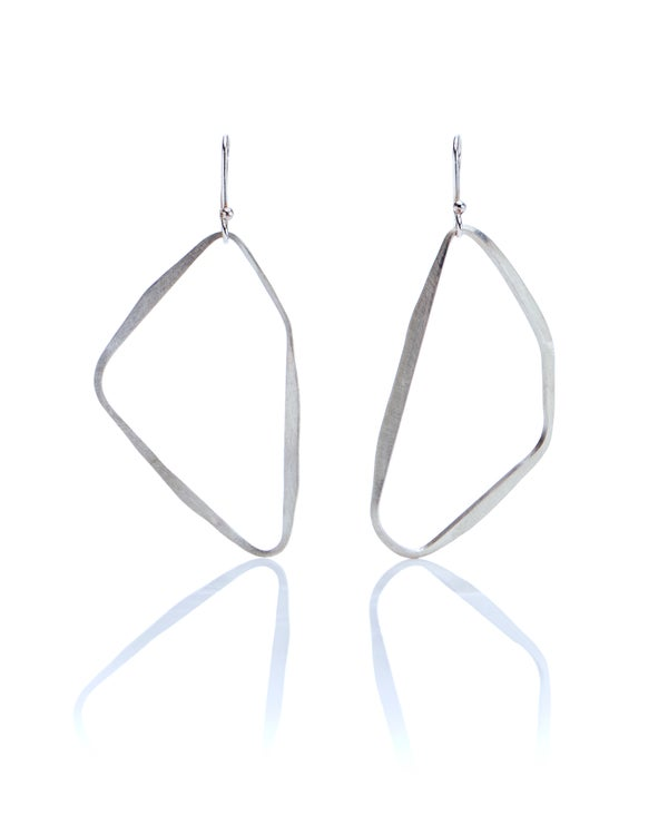 Image of asymmetric paired silver loop earrings