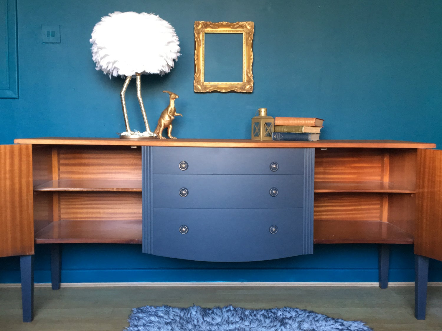 Image of A dark grey sideboard with a naked top.