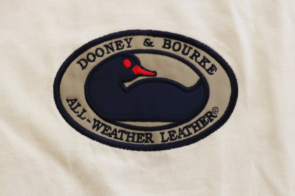 Image of Vintage 1990's Dooney & Bourke Embroidered Patch T-Shirt Sz.S