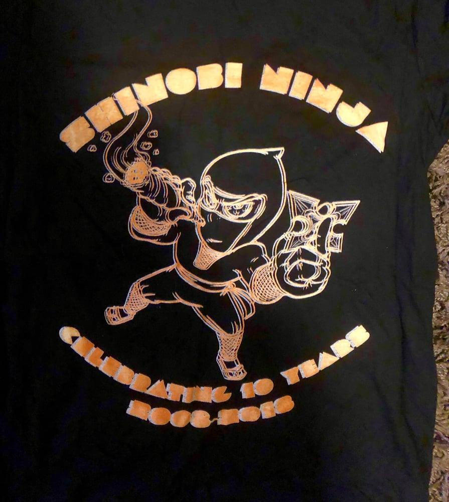 Image of Shinobi Ninja 10 Year Anniversary Ninja Smoking A Joint Shirt