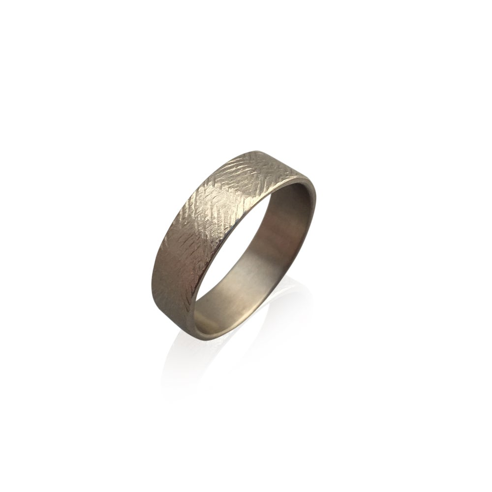Image of scuffy band is 14k palladium white gold