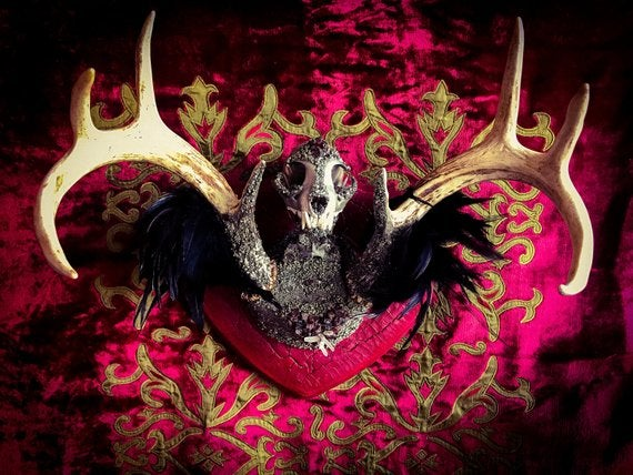 Image of Garnet Embellished Bobcat Skull Deer Antler and Fox Bones - Jewelry Display.