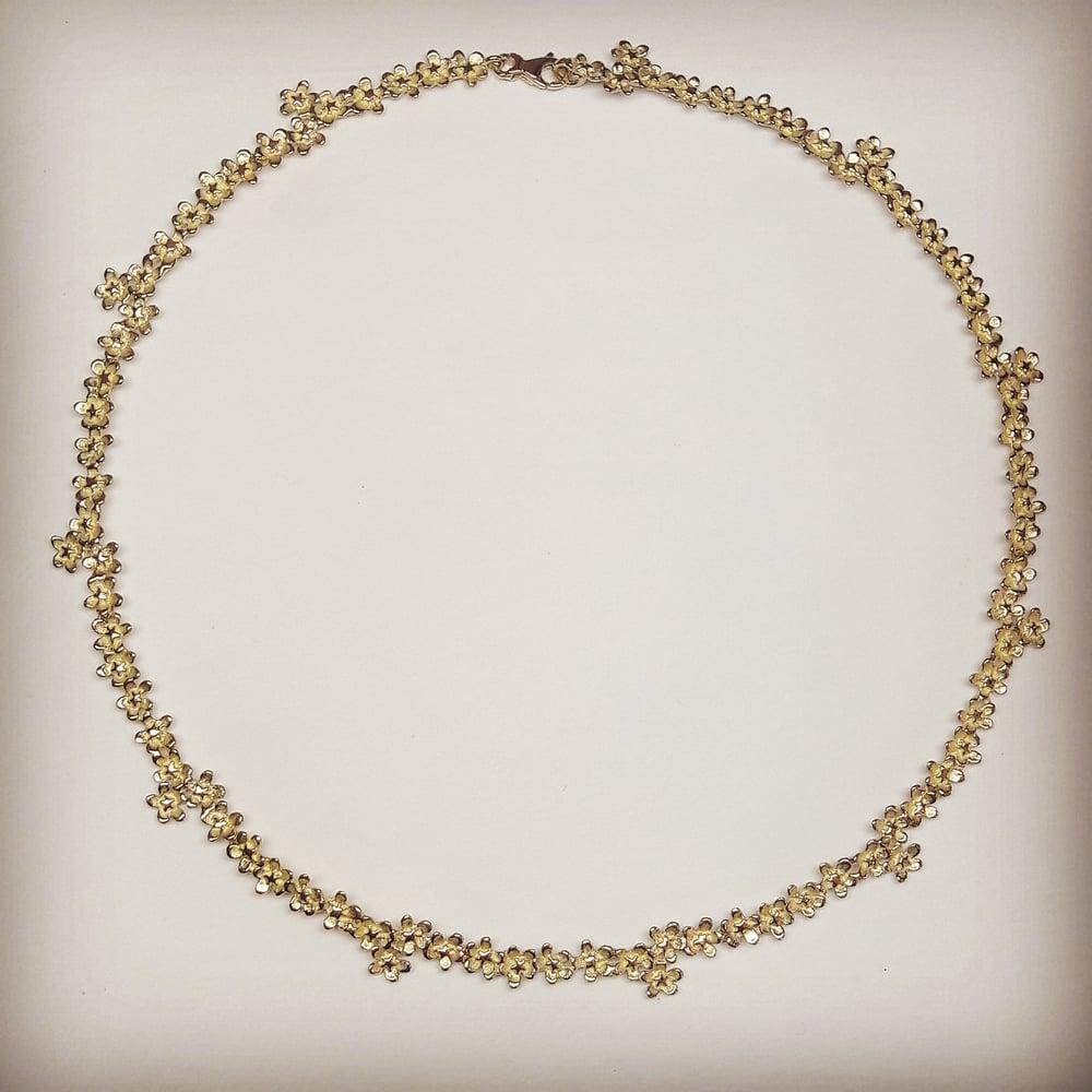Beeld van Flower necklaces