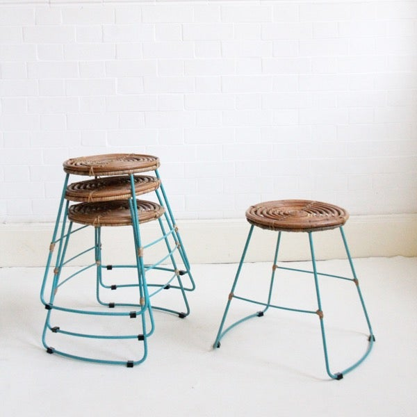 Image of Rattan Stackable Stools with turquoise frame, set of four.