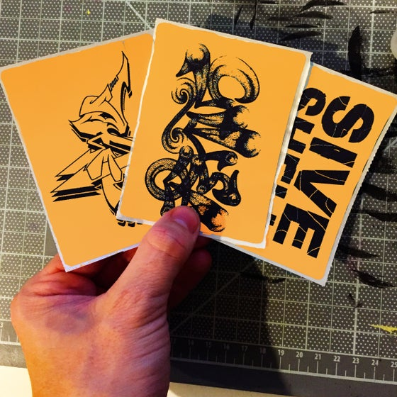 Image of Custom Orange Thermal Transfer Stickers