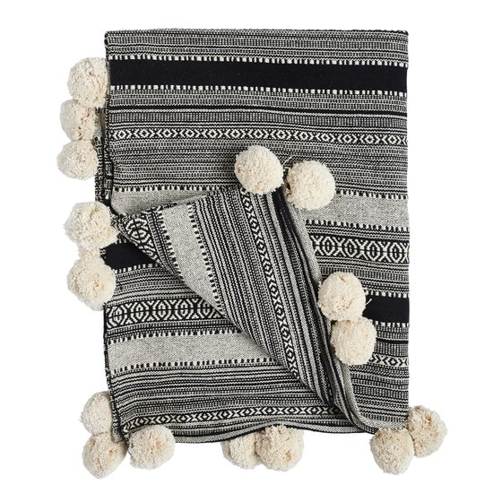 Image of K o i v u pom pom blanket, black