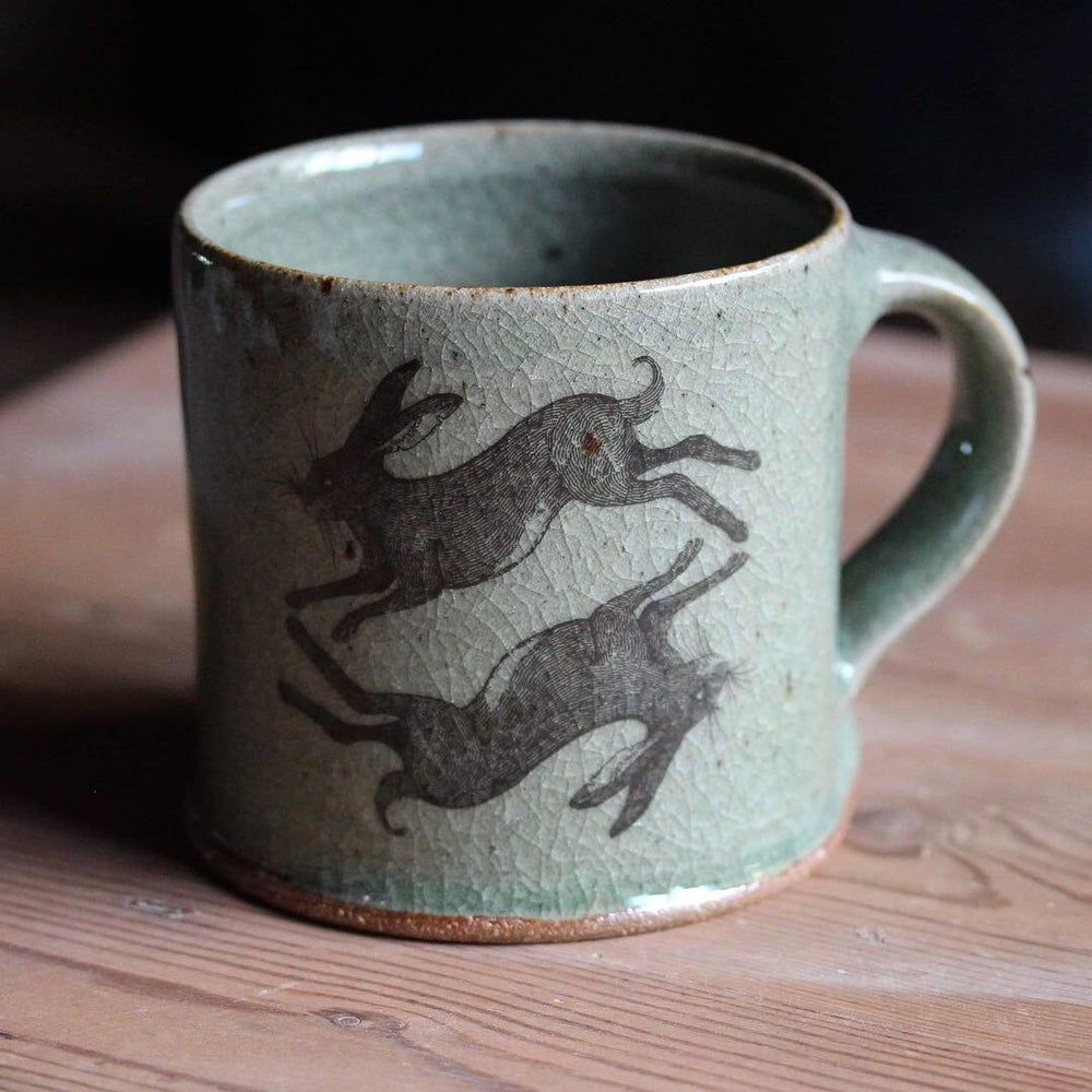 Image of Hare and Rook Mug. Green Celadon glaze.