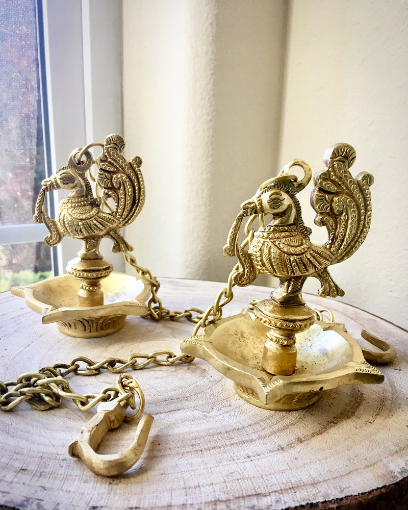 Image of A pair of cute Brass Hanging Diyas