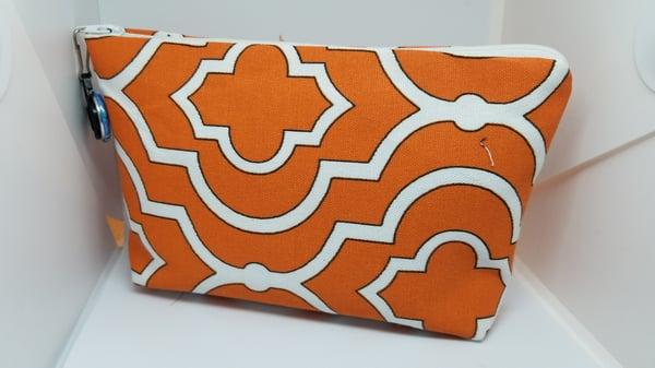 Image of Orange make up bag