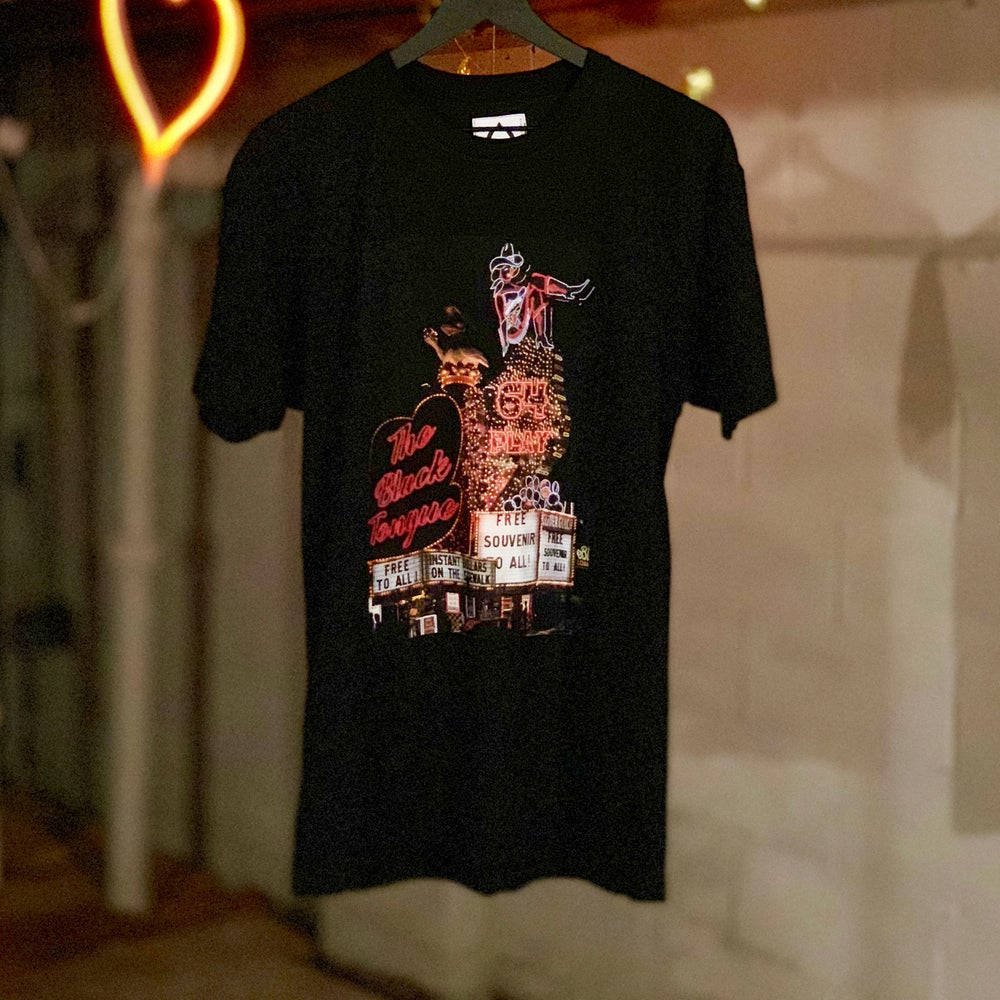 Image of the souvenir strip tee