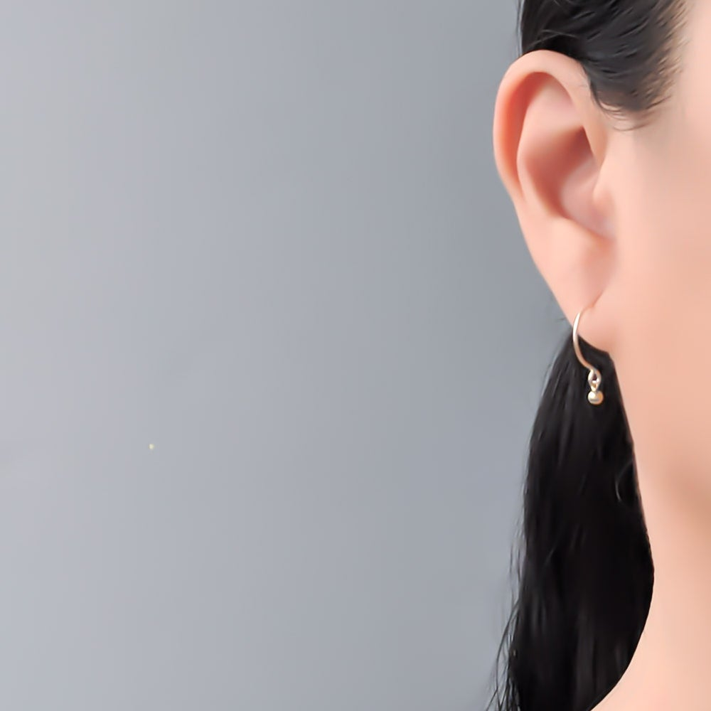 Image of Tiny gold ball hoop earrings