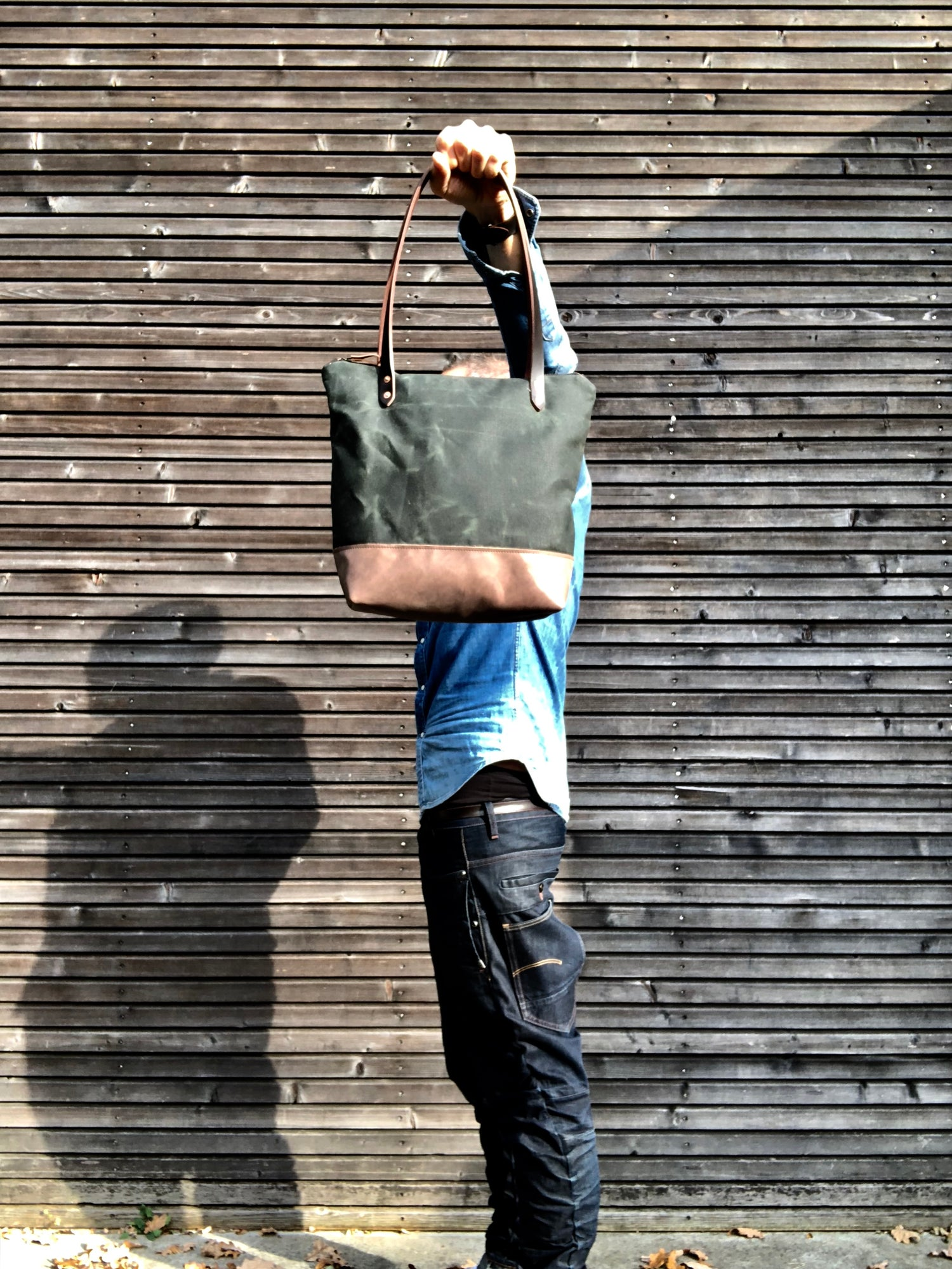 Image of Waxed canvas tote bag with leather handles and zipper closure