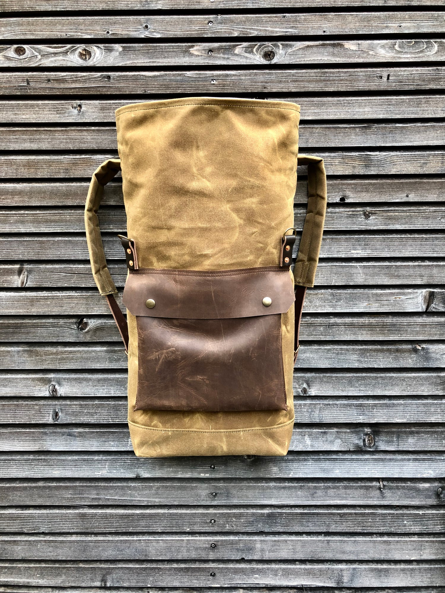 Image of Waxed canvas rucksack/backpack with roll up top and double waxed bottem COLLECTION UNISEX