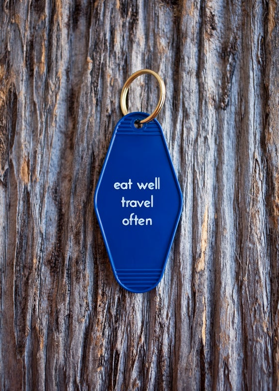 Image of eat well travel often keytag