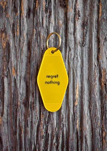 Image of regret nothing keytag