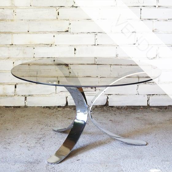Image of table basse en verre fumé et pied chromé