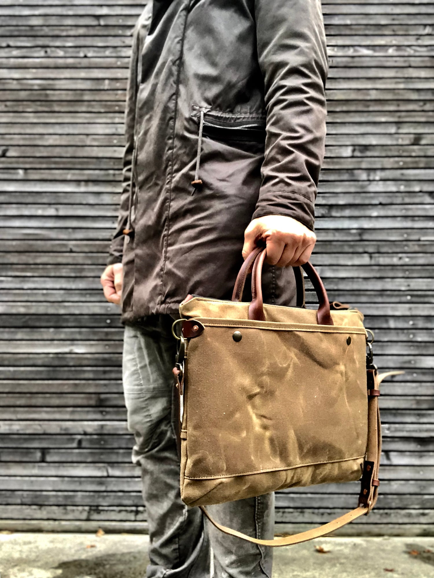 Image of briefcase in waxed canvas and leather with luggage handle attachment on the back COLLECTION UNISEX