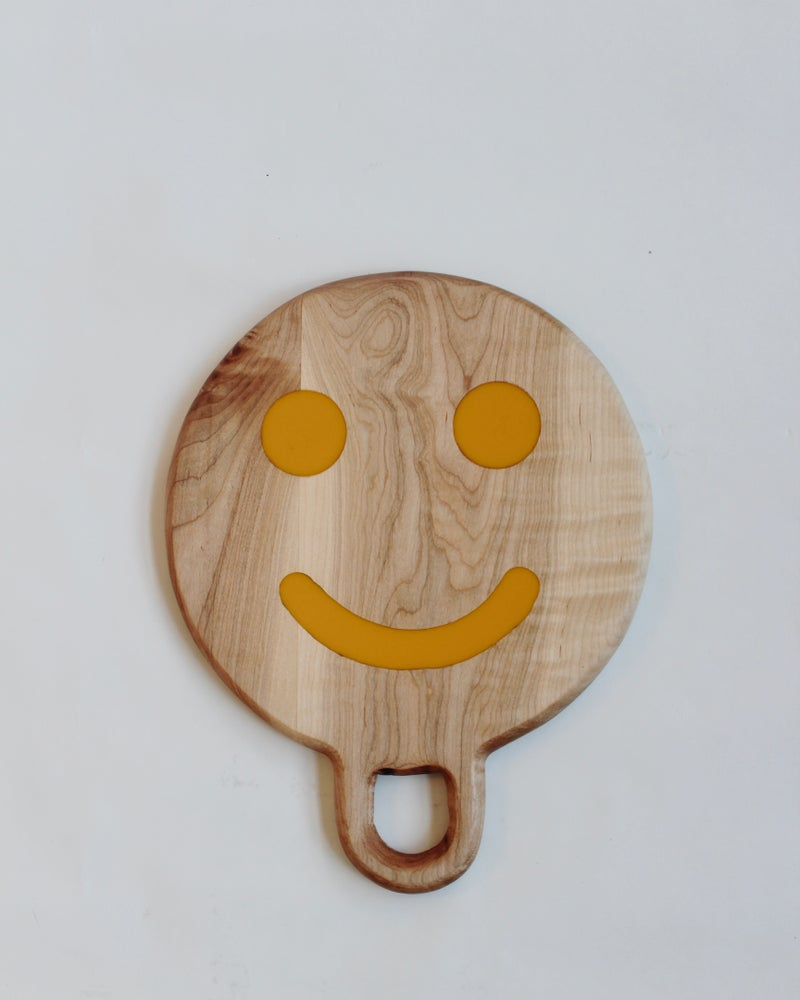 Image of Smiley Yellow on Found Wood