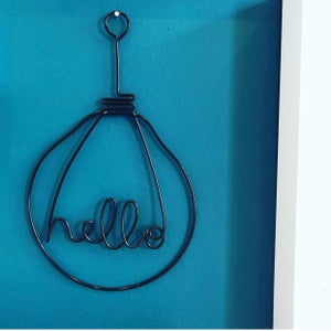 Image of Wire HELLO lightbulb