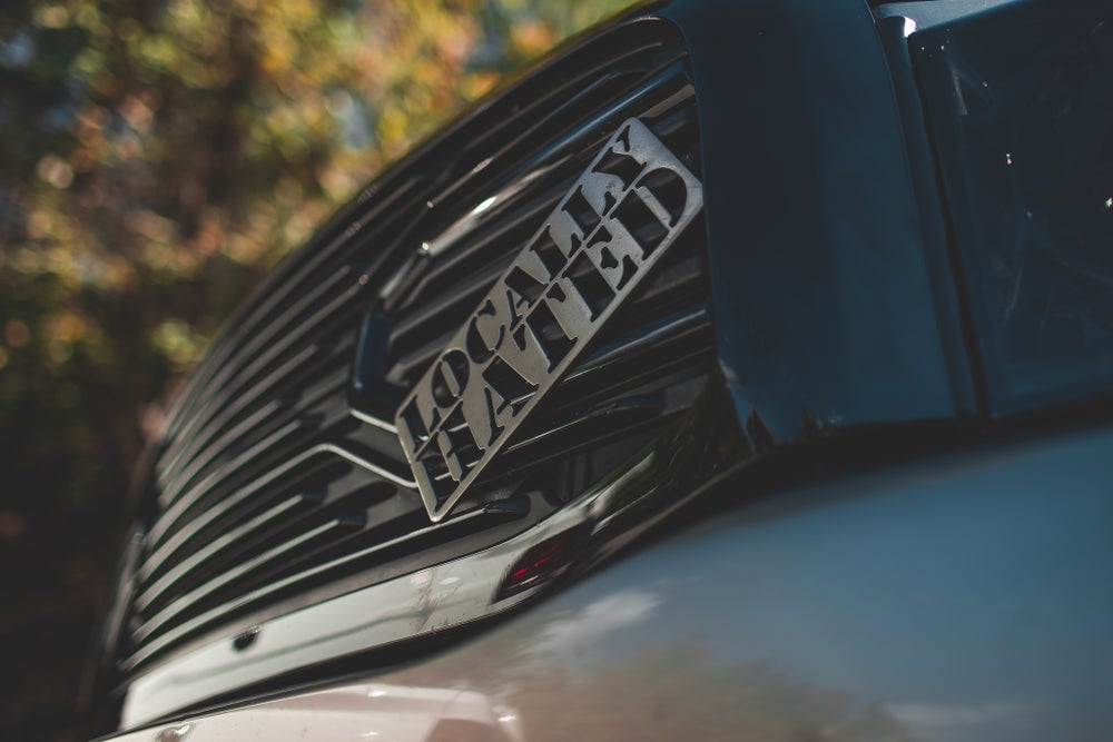 """Image of Dual plate Steel LOCALLY HATED grille badge 9""""x 4"""""""