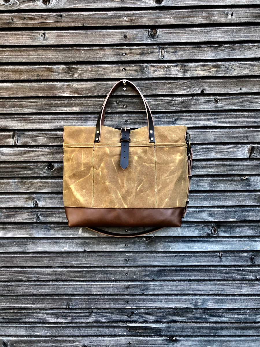 Image of  Tote bag in waxed canvas with leather bottom and cross body strap