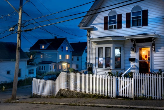 Image of OPEN DOOR, FRIDAY NIGHT. TRASK ST, GLOUCESTER MA. DUSK