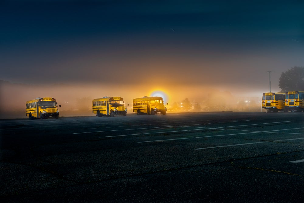 Image of SCHOOL BUSES, GLOUCESTER MA. NIGHTFALL.