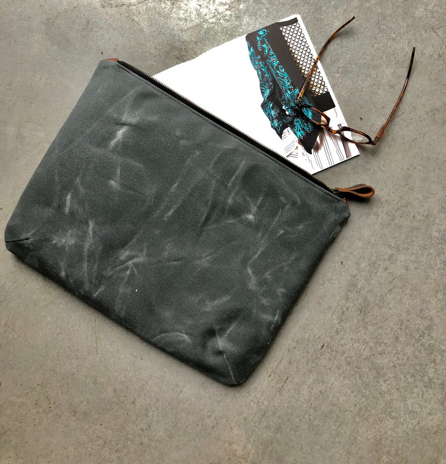 Image of laptop case in waxed canvas