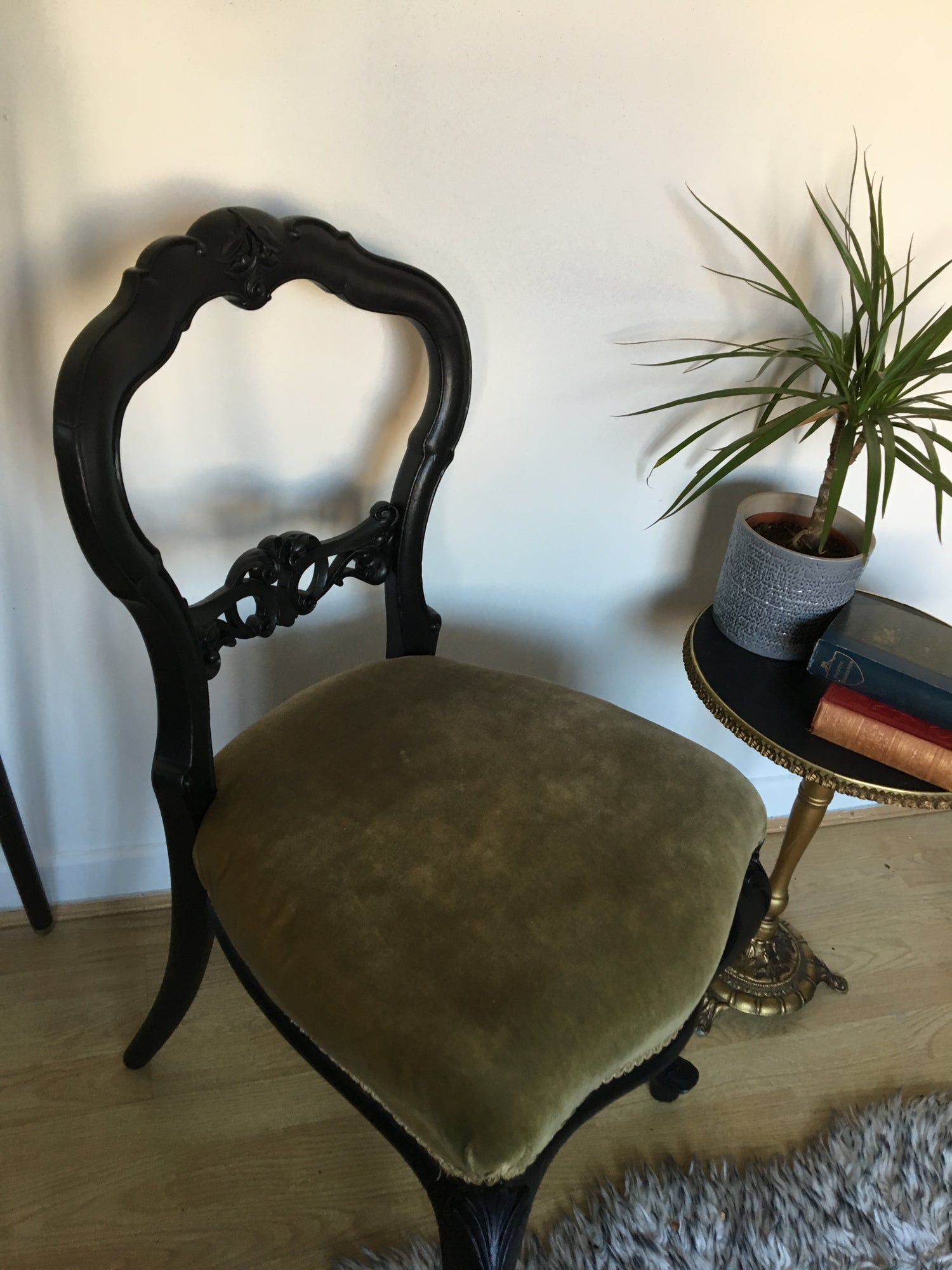 Image of A black & green vintage chair
